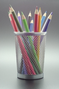 cup with array of colored pencils