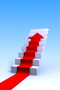 red arrow climbing to top of white stairs